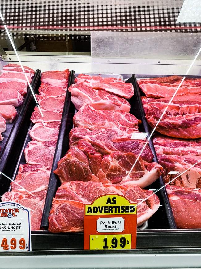 fresh pork butt in butcher window