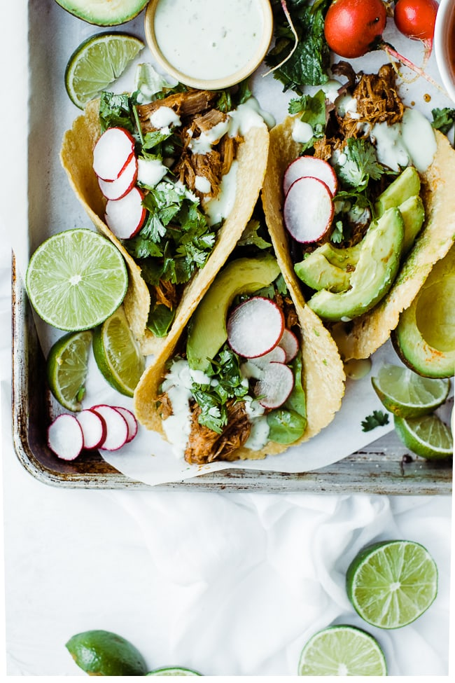 three sweet pork tacos with avocado
