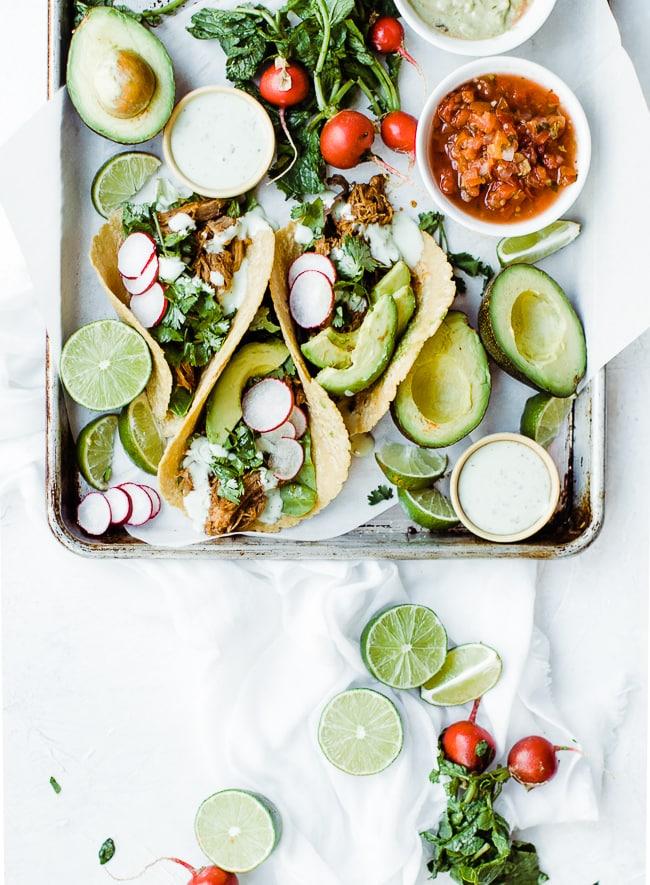 sweet pork tacos on tray
