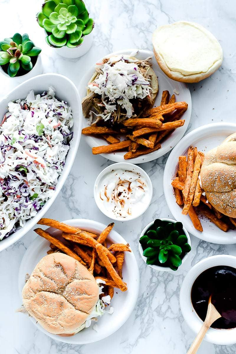 The Best Pulled Pork Recipe on burger buns, served with fries