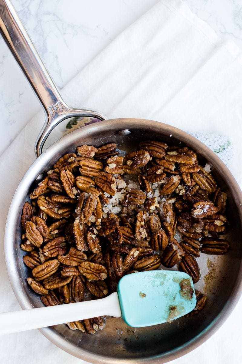 candied pecans cooking in pan