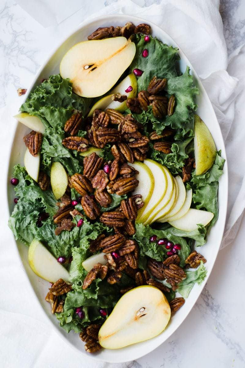 candied pecans atop pear salad