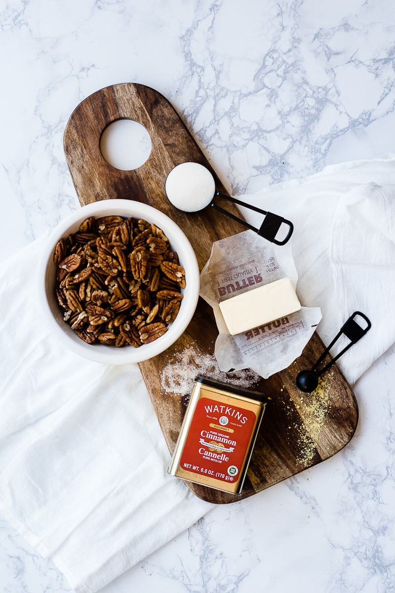 candied pecan ingredients over wooden cutting board
