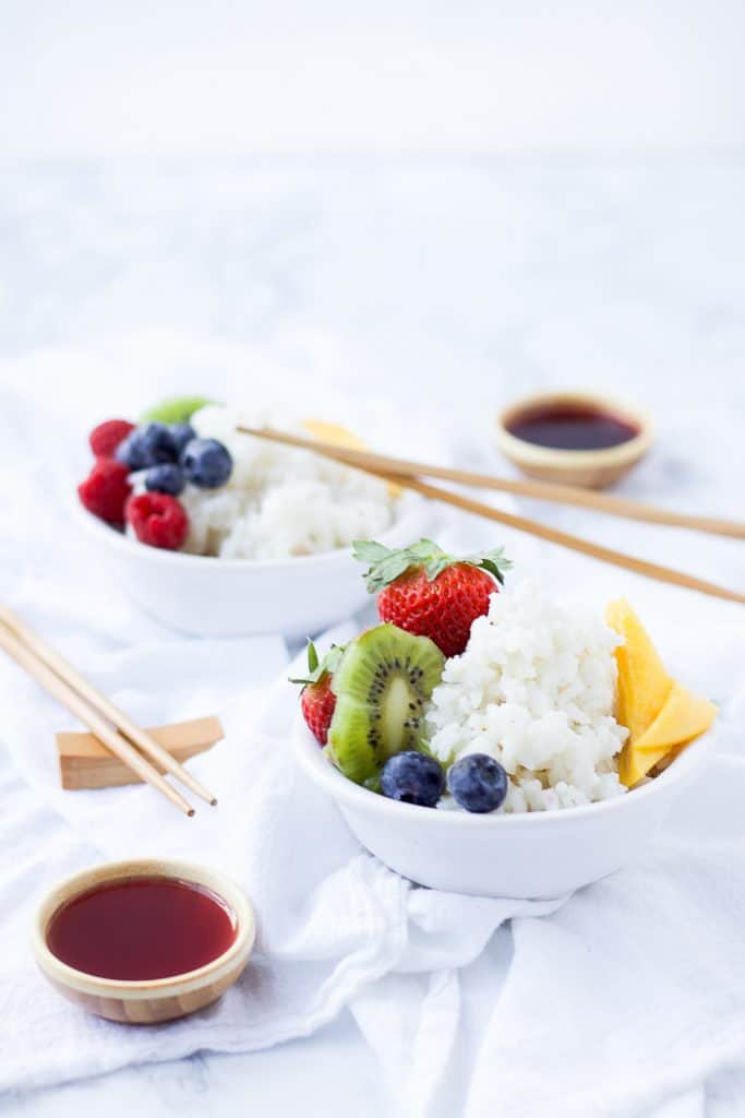 Easy Coconut Rice in a bowl topped with berries and fruit