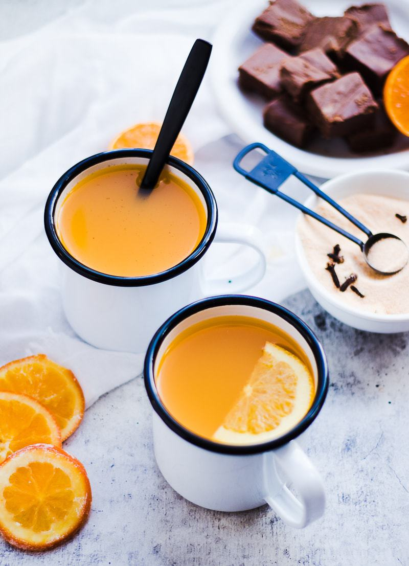 Spiced Orange Cider in mugs with orange garnish