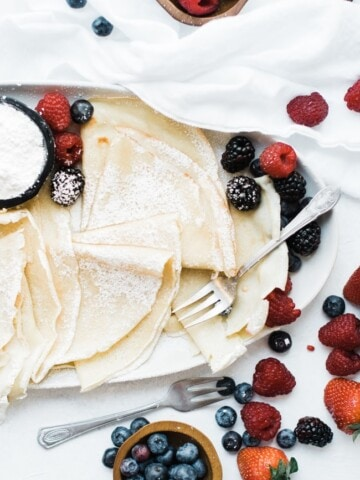 platter of crepes turned sideways with fluffy crepes