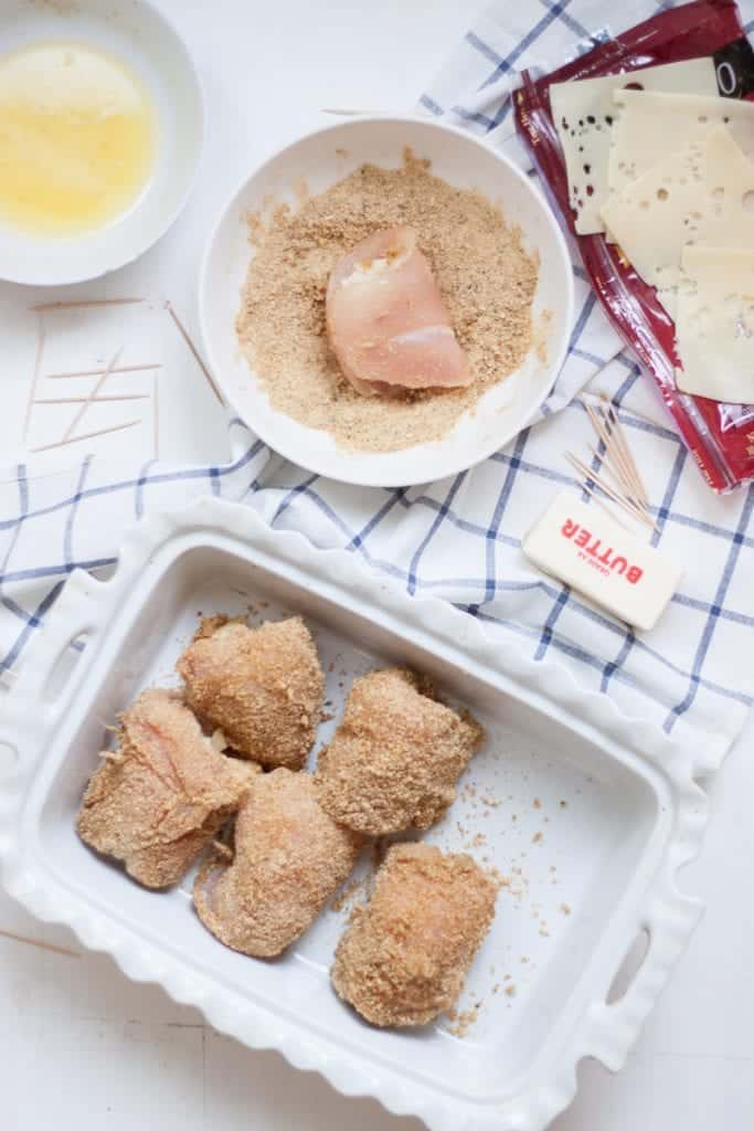 pre-cooked chicken cordon bleu in a white baking dish