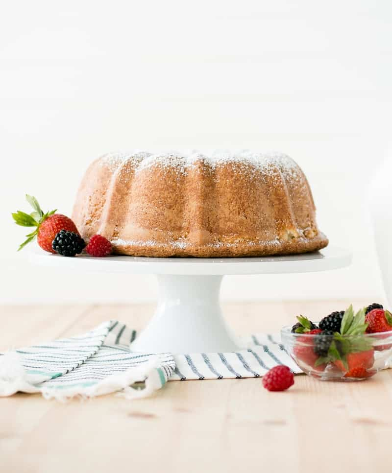 Sour Cream Pound Cake on cake stand with berrys