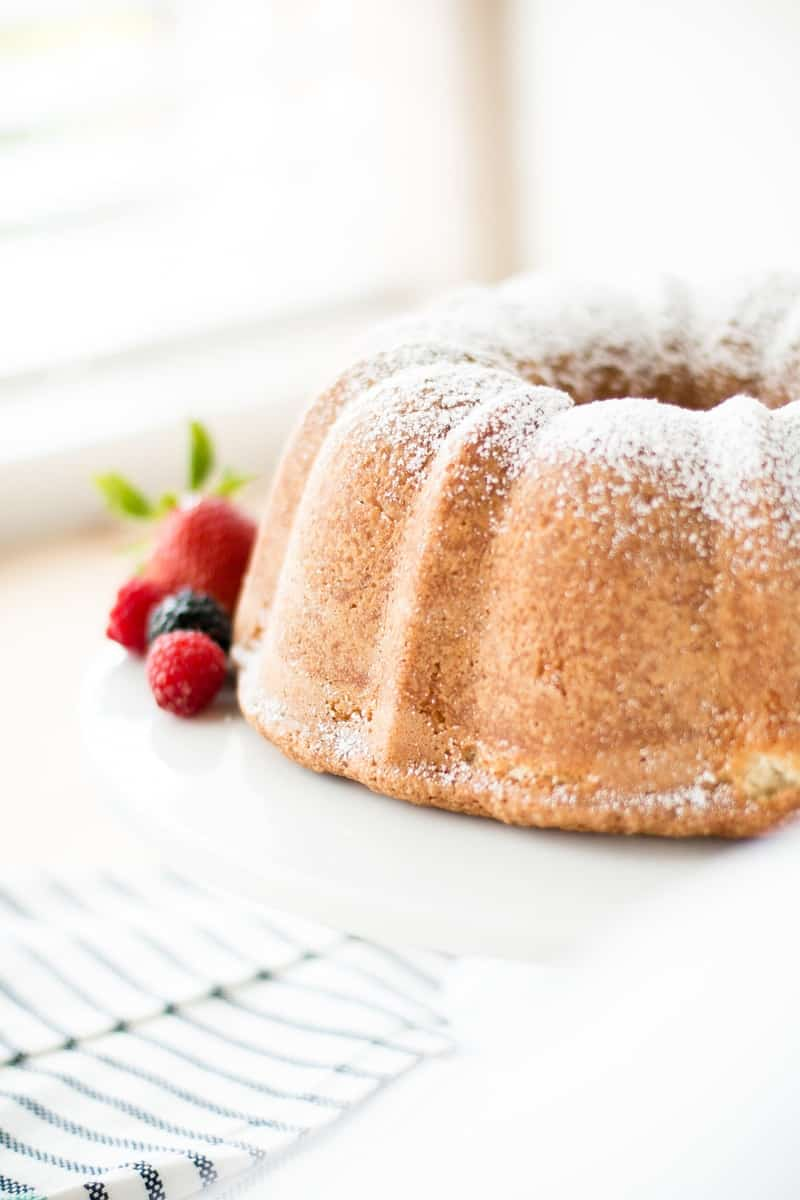 close up of Sour Cream Pound Cake with berrys