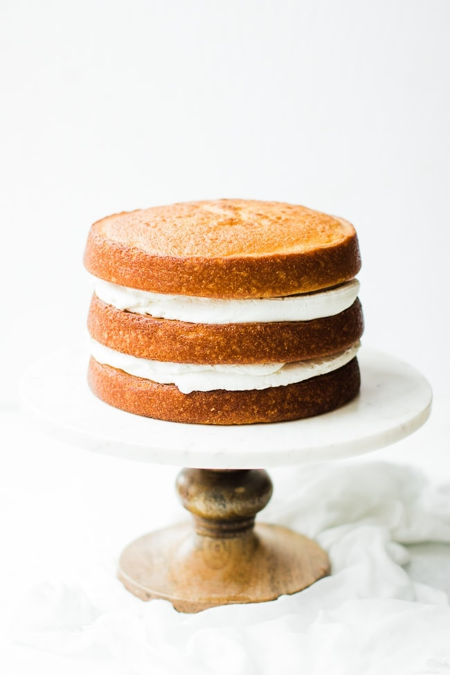 three layer cake, stacked with frosting in-between.