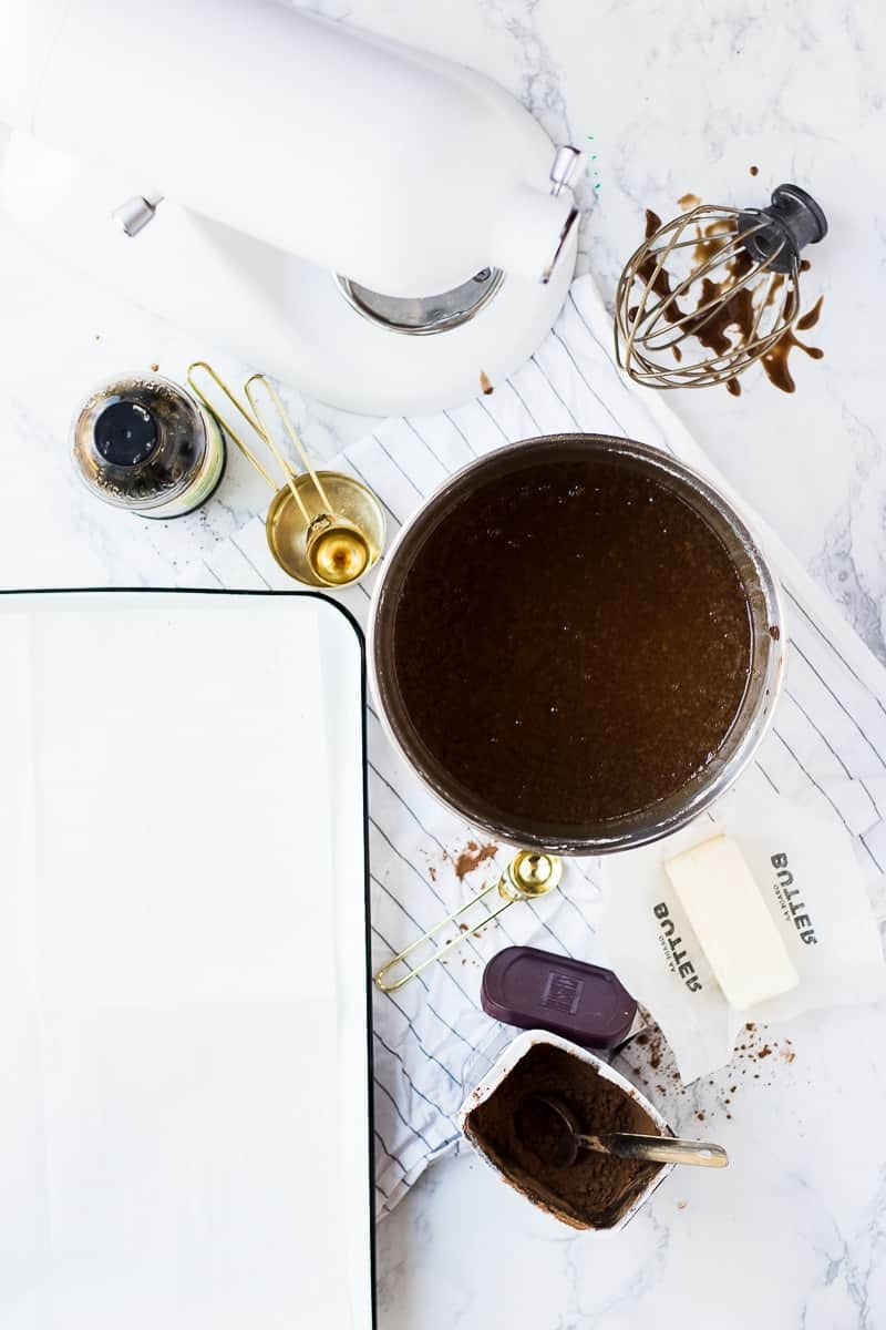 Ingredients and equipment for a Scotch Chocolate Cake on a marble surface