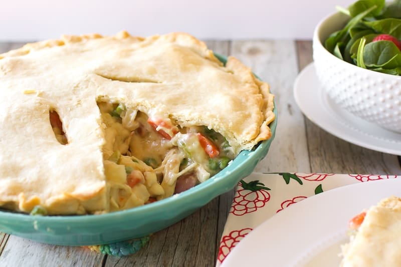 Chicken Pot Pie that has been cut into with salad to the side