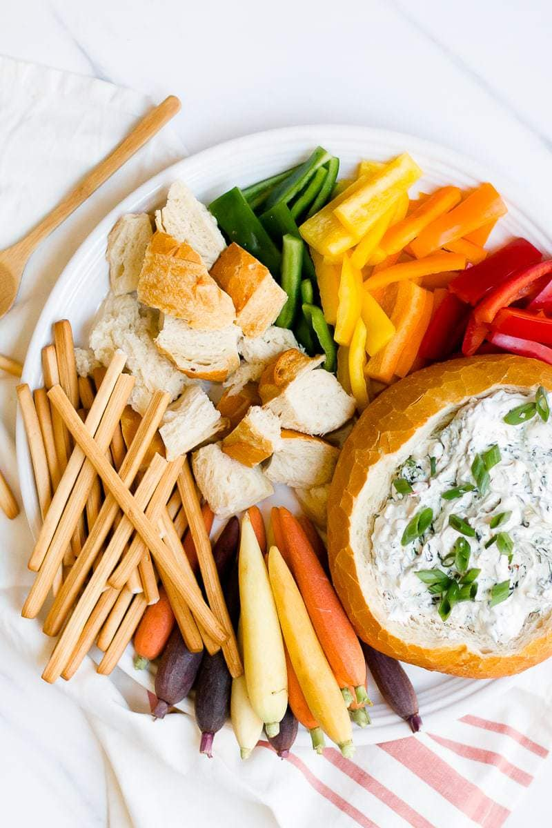 An overhead shot of an Easy Spinach Dip on a plate with vegetables