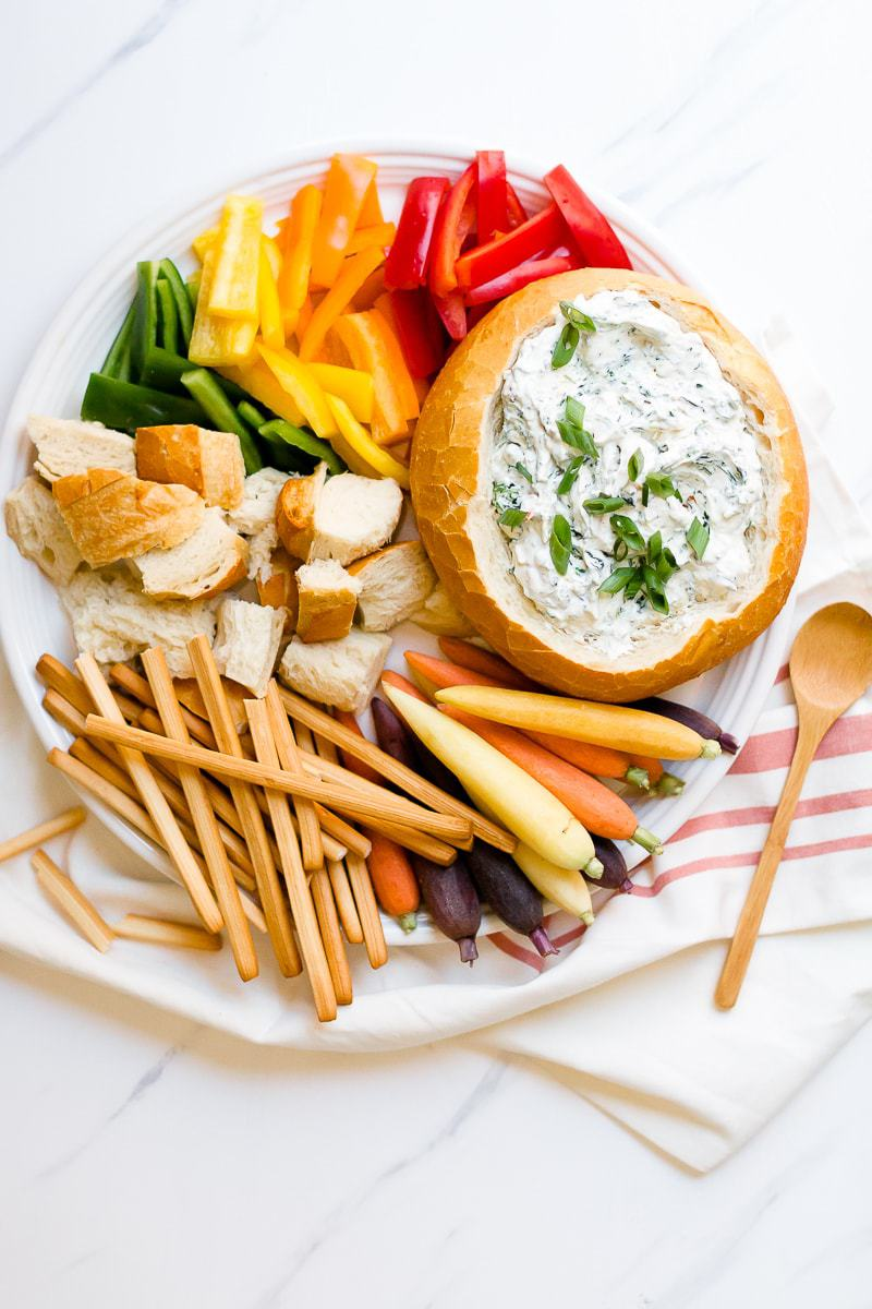 Easy Spinach Dip on a plate with carrots and bell peppers