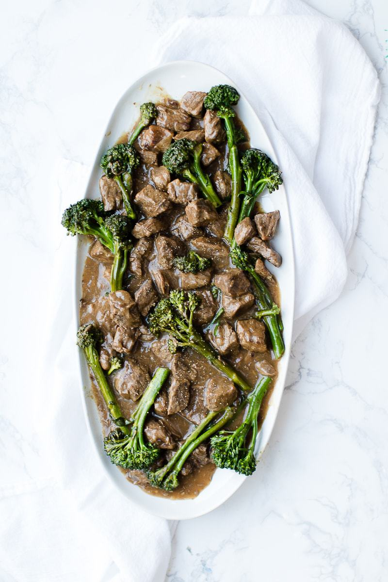beef and broccoli on white serving platter
