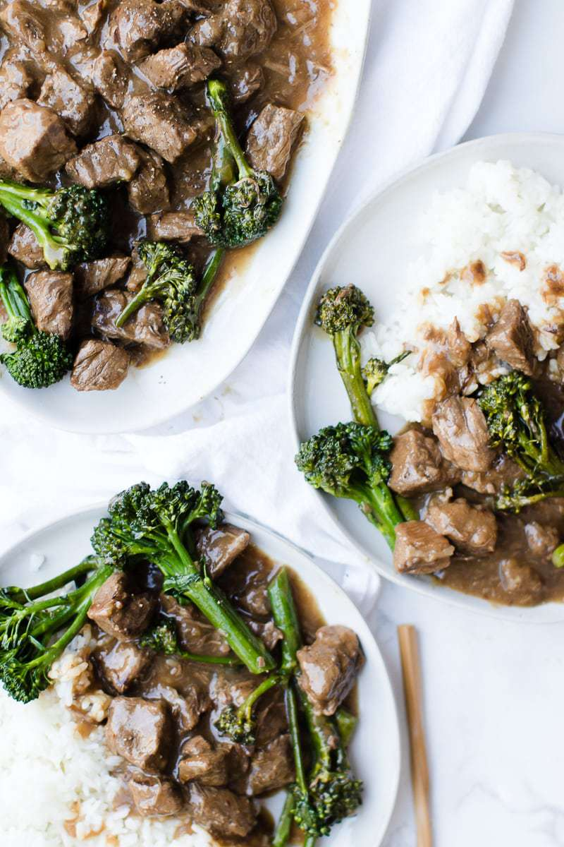 beef and broccoli on white plates