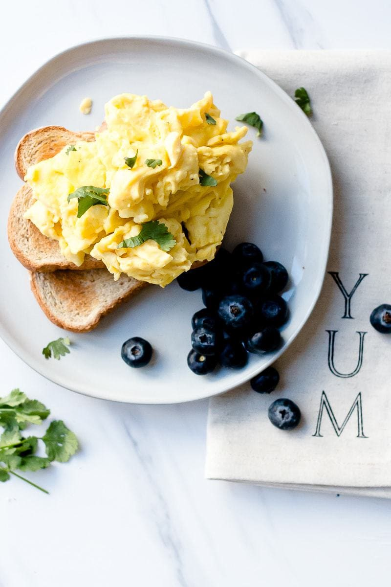 The Best Scrambled Eggs Recipe featured by popular food blogger, Oh So Delicioso