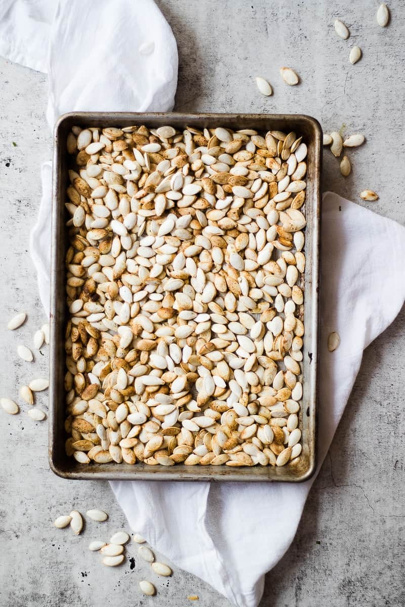 Roasted Pumpkin Seeds on a sheet pan