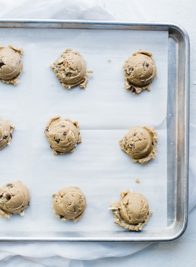 cookie dough on cookie sheet with parchment paper