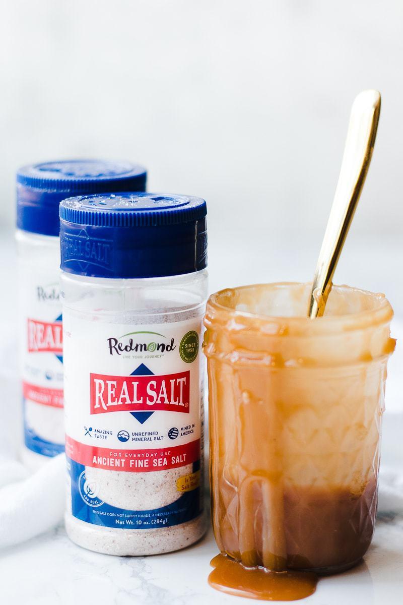 Redmond sea salt next to jar of caramel