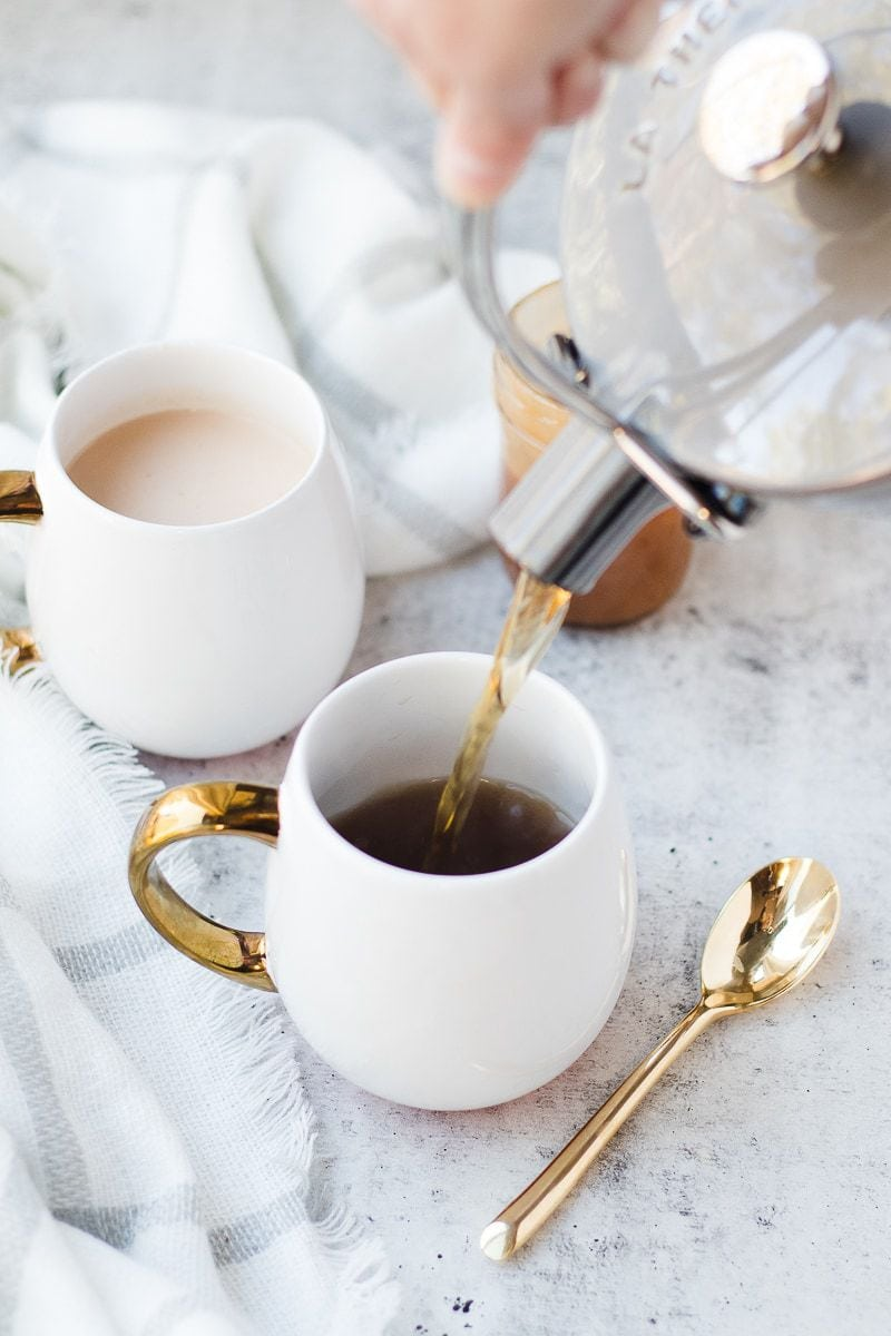 spice drink being poured into mugs