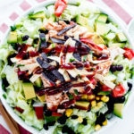 bbq chicken salad cpk in a white bowl