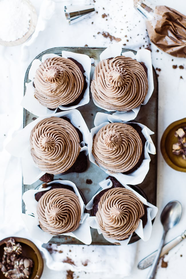flatlay view of frosted cupcakes