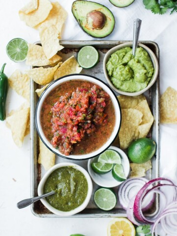 fresh salsa, chips and guac on a tray