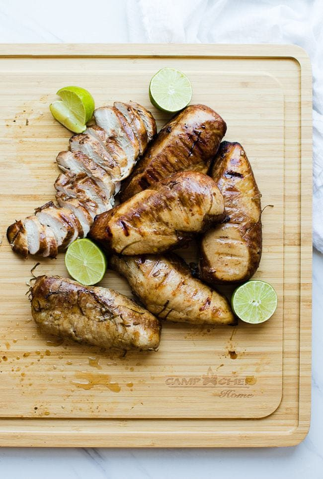 smoked chicken breasts on cutting board