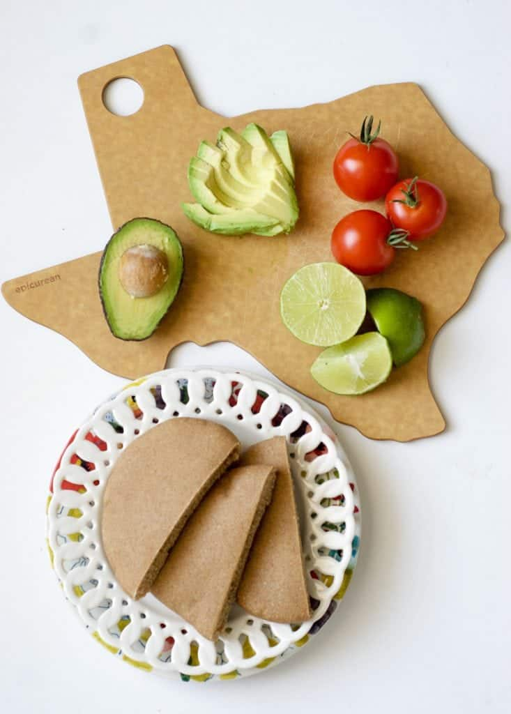 Tomato and Avocado Pita ingredients on cutting board in the shape of Texas