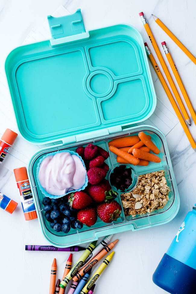non-sandwich school lunch with yogurt, granola, and berries in an aqua lunchbox.