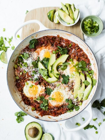 huevos ranchers in pan of salsa cooked