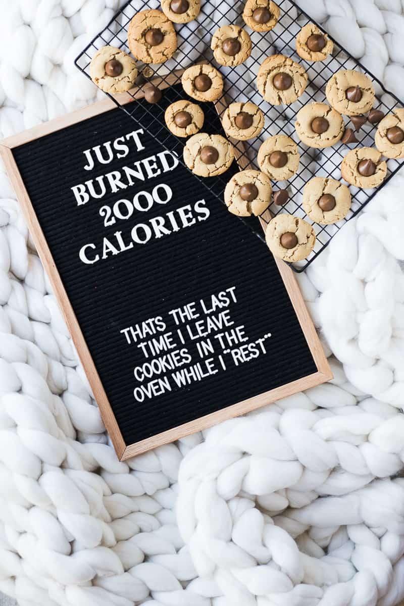 Peanut Butter Blossoms Cookies beside a message board