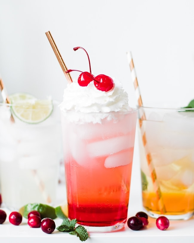 italian soda with whipped cream and cherries on top