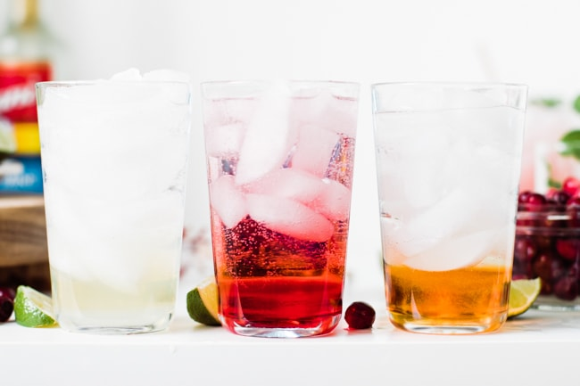 3 cups with sparkling water mixed with ice and syrup