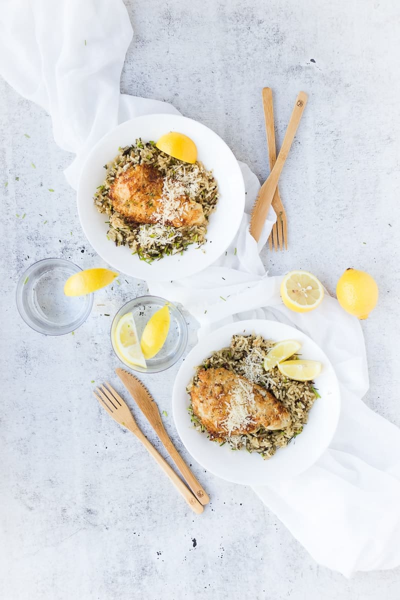 overhead shot of two bowls of parm crusted tilapia