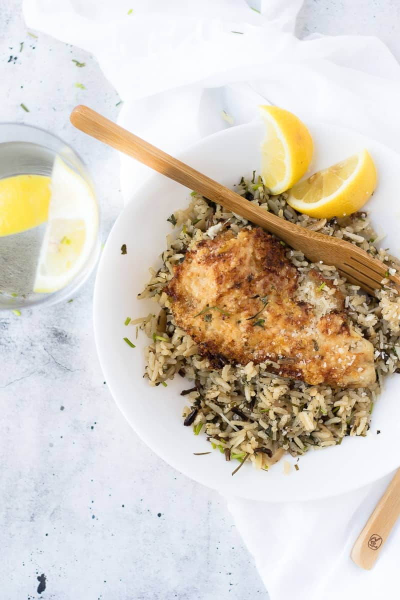 Parmesan Crusted Tilapia Recipe with rice and lemon wedges
