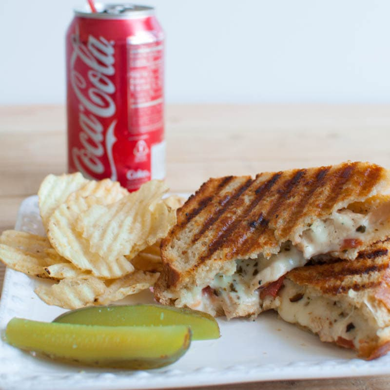 Chicken Pomodori Panini with Roasted Garlic Butter and Pesto Mayo