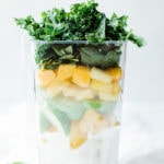 coconut water, mango, apple, pineapple and kale in blender