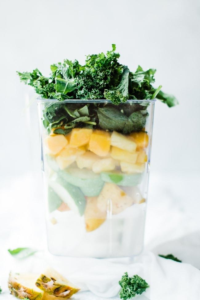 coconut water, mango, apple, pineapple and kale in blender