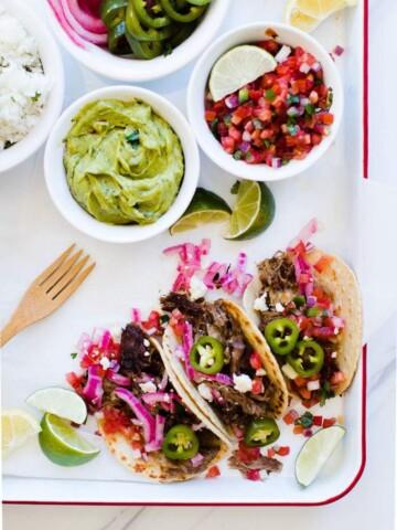 Authentic Carnitas Recipe featured by popular Los Angeles food blog, Oh So Delicioso
