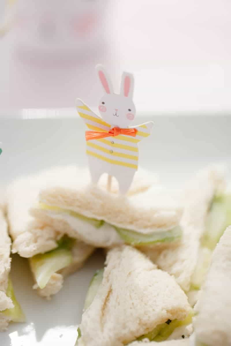A photo of a pile of cucumber sandwiches for and Easter brunch on a plate