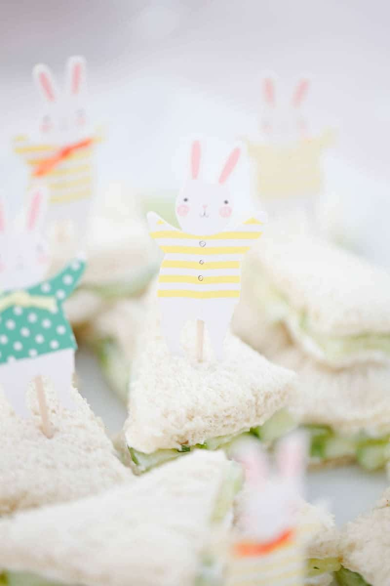 A photo of an Easter brunch with bunny decoration in English tea cucumber sandwiches