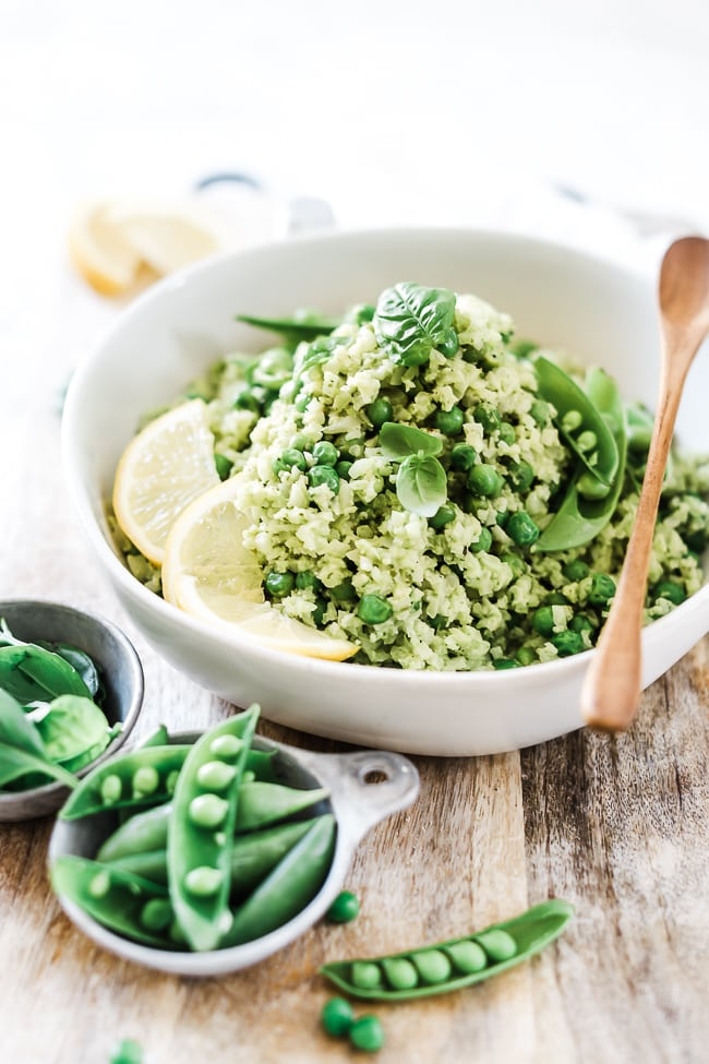Lemon pesto cauliflower rice recipe in a white bowl.