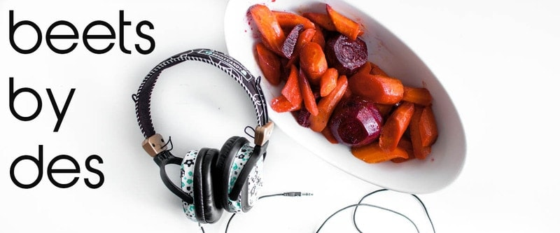"A dish of beets and carrots with headphones and words, ""Beets by Des"" next to them"