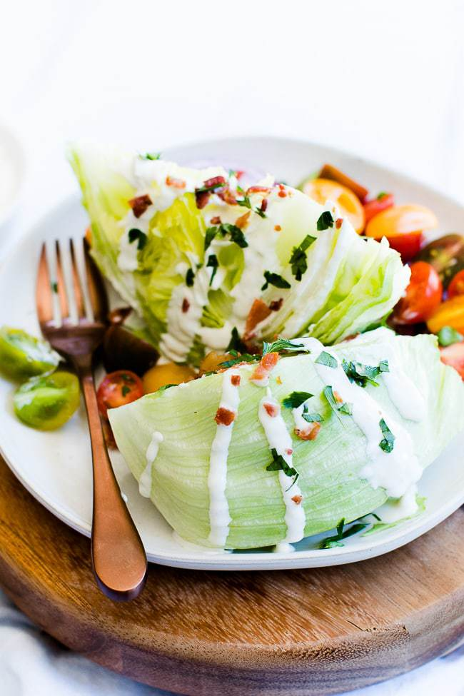 side angle of wedge salad with dressing