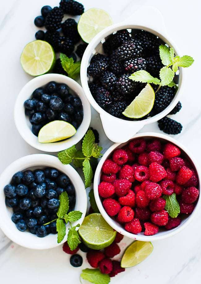blueberries, raspberries and black berries in bowls for making tripe berry popsicles