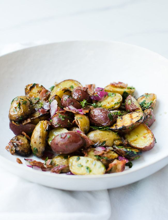 grilled potato salad in a white bowl