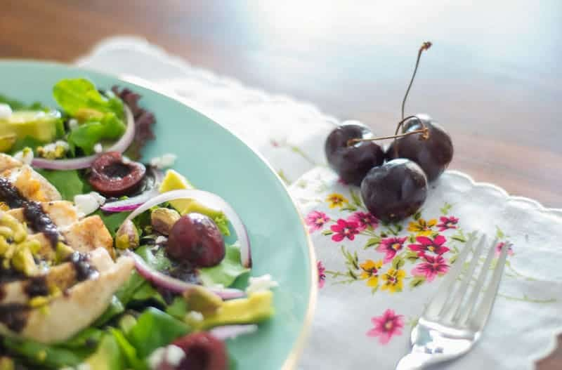 Cherry salad with cherries on the side with fork