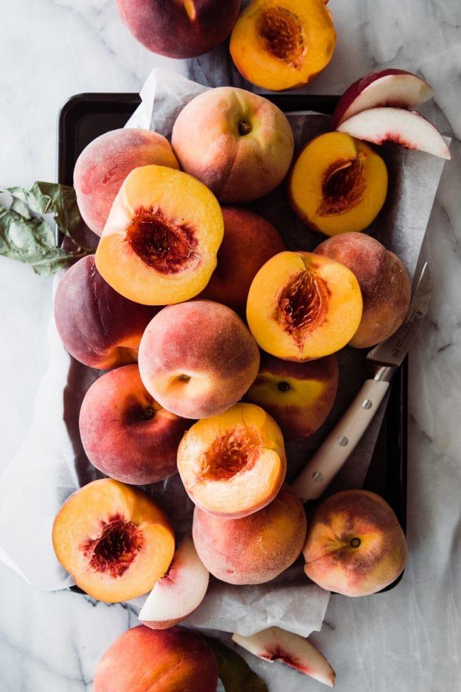 fresh peaches on a tray